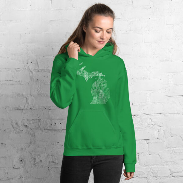 woman wearing a kelly green hooded sweatshirt with a white line drawing of the state of michigan
