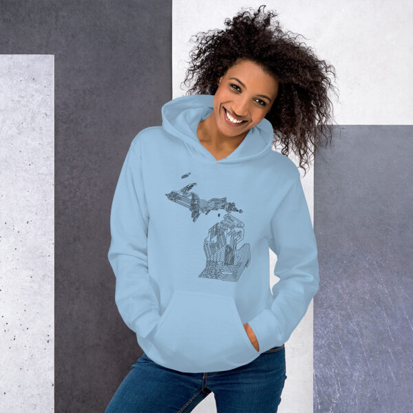 woman wearing a light blue hooded sweatshirt with a black line drawing of the state of michigan