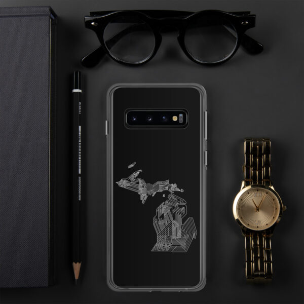 samsung phone case with a white line drawing of the state of michigan on a black background sitting next to a watch