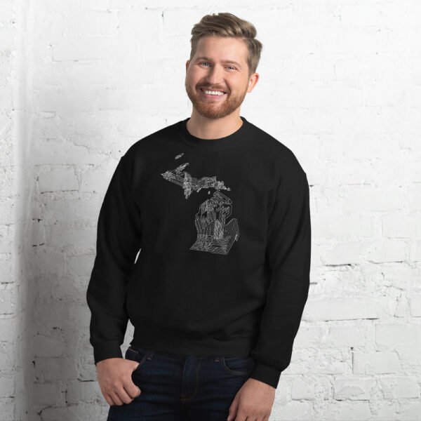 man wearing a black long sleeve sweatshirt with a white line drawing of the state of michigan design