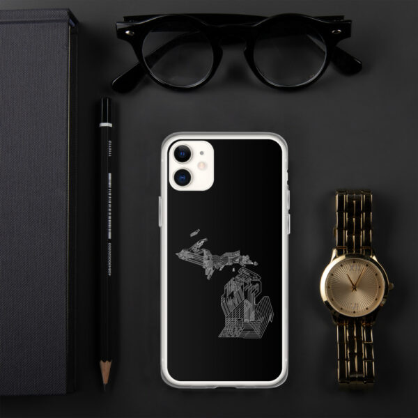 iphone case with a white line drawing of the state of michigan on a black background sitting next to a watch