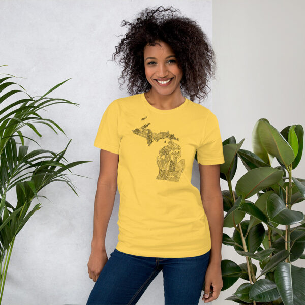 woman wearing a golden yellow short sleeve t-shirt with a black line drawing of the state of michigan design