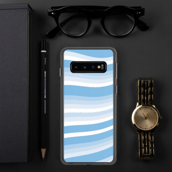 samsung phone case with wavy blue and white lines in a cirrus cloud design sitting next to a watch