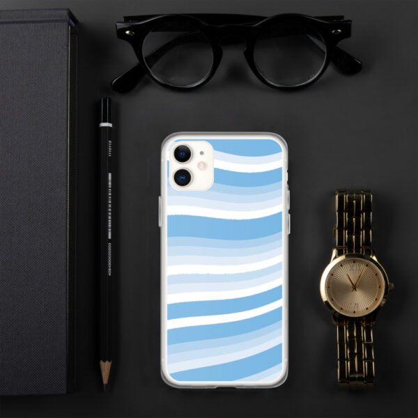 iphone case with blue and white wavy lines in a cirrus cloud design sitting next to a watch