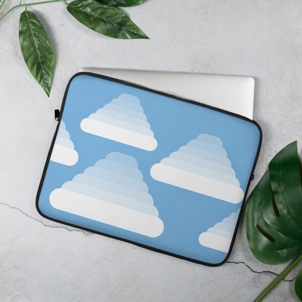 laptop sleeve with three fluffy white clouds on a blue background sitting on a table