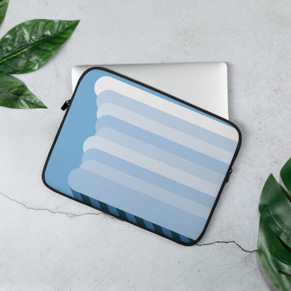 laptop sleeve with a big fluffy rain cloud on a blue background sitting on a table