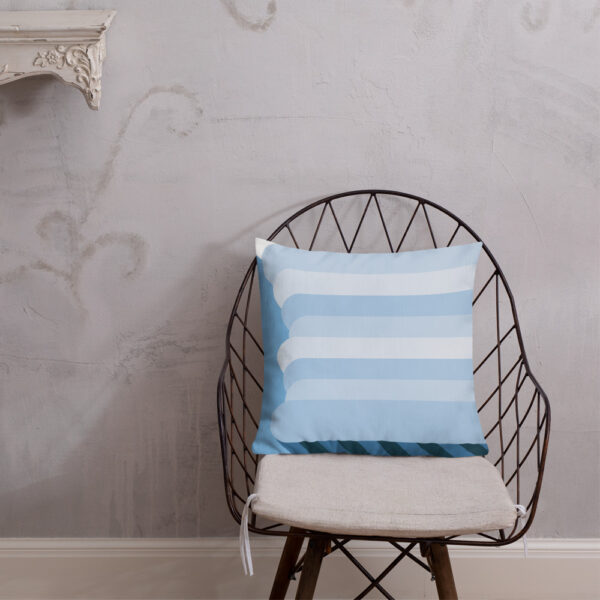 square pillow with a tall white nimbus rain cloud a blue background sitting on a chair