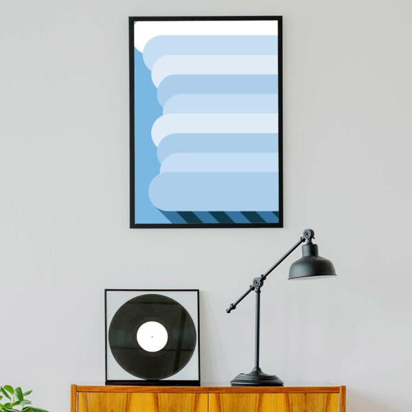 vertical fine art print of a minimalist rain cloud design on a blue background in a black frame hanging on a wall
