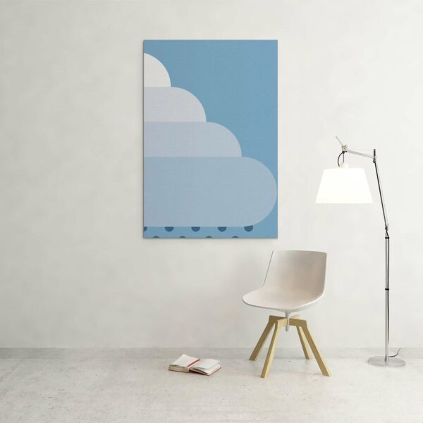 large vertical stretched canvas art print of a big fluffy white rain cloud on a blue background hanging on a wall