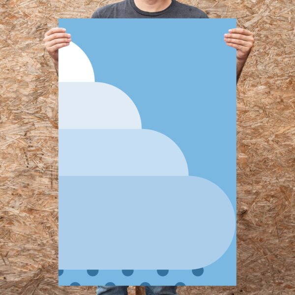 person holding a large vertical fine art print of a large minimalist white rain cloud on a blue background