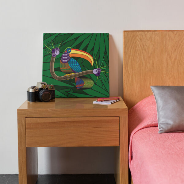 square stretched canvas art print with a colorful toucan in a rainforest design on a nightstand