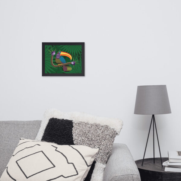 horizontal fine art print of a colorful toucan with a green leaf background in a black frame hanging on a wall above a sofa