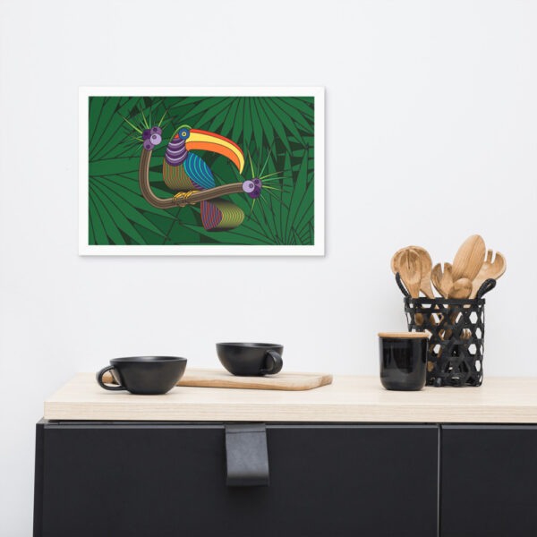 horizontal fine art print of a colorful toucan with a green leaf background in a white frame hanging on a wall in a kitchen