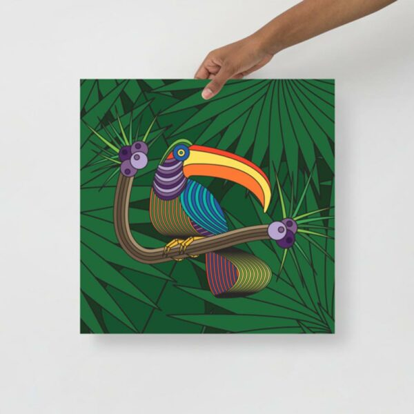person holding a square fine art print of a colorful toucan with a green leaf background