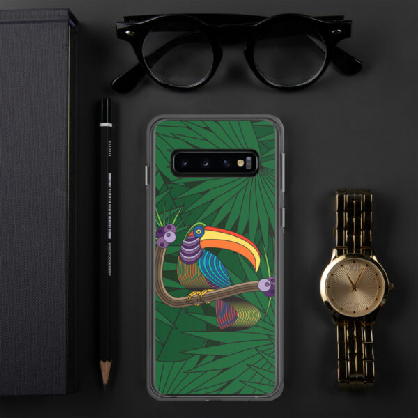 samsung phone case with a colorful design of a toucan in front of green leaves sitting next to a watch