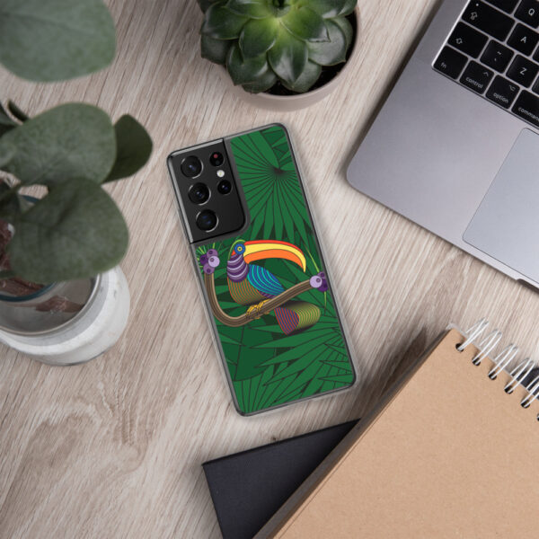 samsung phone case with a colorful design of a toucan in front of green leaves sitting next to a laptop