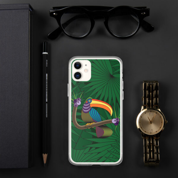 iphone case with a colorful design of a toucan in front of green leaves, sitting next to a watch