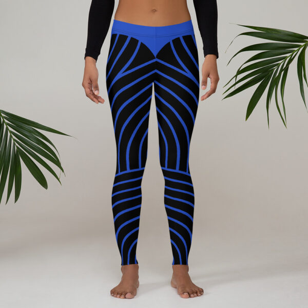 woman wearing black and blue striped leggings next to plants