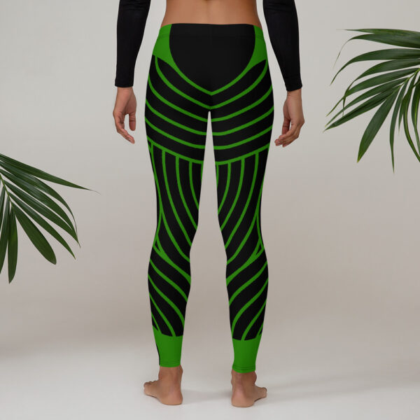 woman wearing black and green striped leggings next to plants