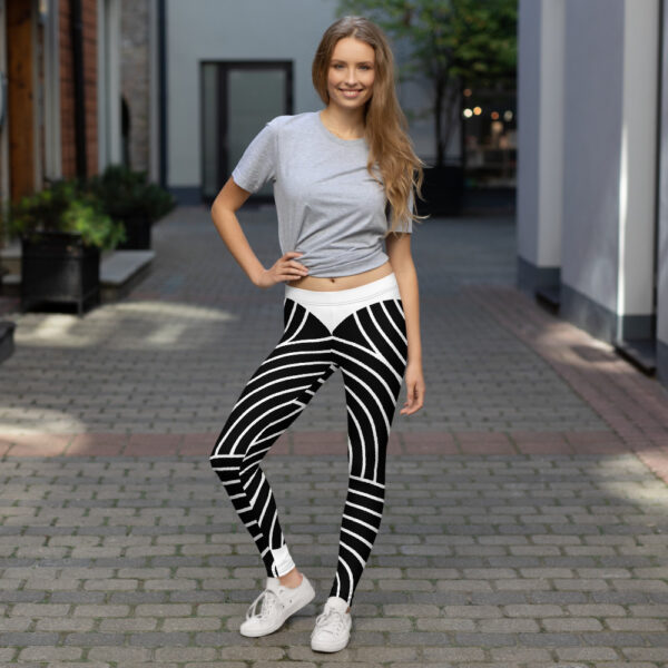 woman standing outside wearing black and white striped leggings
