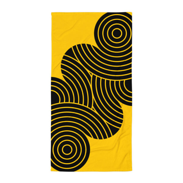 yellow beach towel with an abstract black circle design