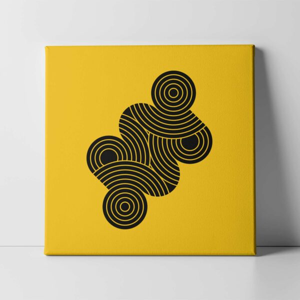 square stretched canvas art print with an abstract group of black circles on a yellow background