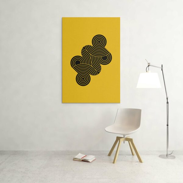 large vertical stretched canvas art print with an abstract group of black circles on a yellow background hanging on a wall