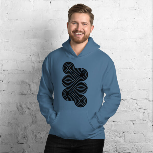 man wearing an indigo blue hooded sweatshirt with an abstract design of black circles on the chest