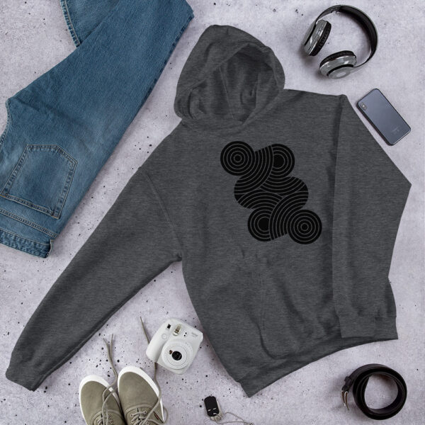 dark grey hooded sweatshirt with an abstract design of black circles on the chest on a table next to jeans
