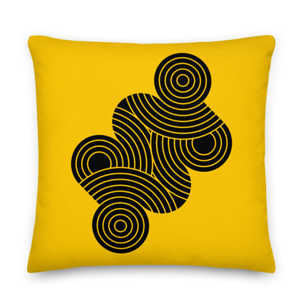22 inch square pillow with an abstract design of black circles on a yellow background