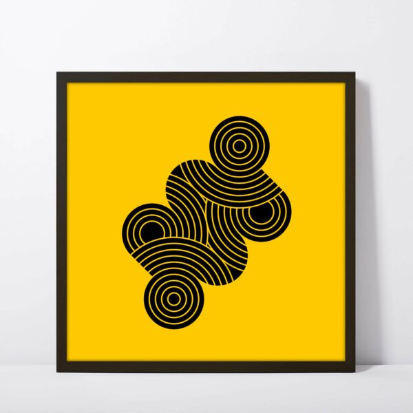 square fine art print with an abstract design of black circle shapes on a yellow background in a black frame