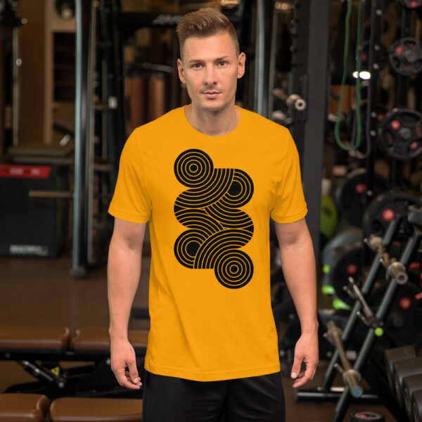 man wearing a golden yellow short sleeve t-shirt with an abstract group of black circles design