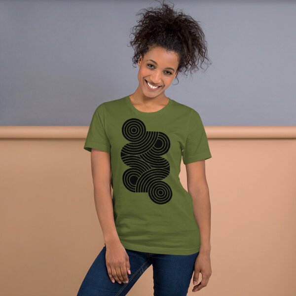 woman wearing an olive green short sleeve t-shirt with an abstract group of black circles design