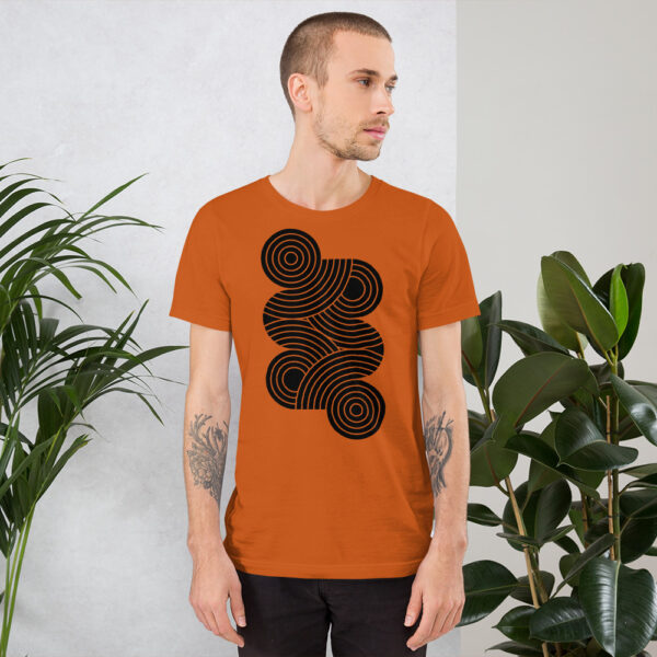 man wearing an orange short sleeve t-shirt with an abstract group of black circles design