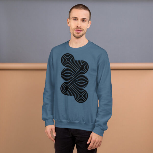 man wearing an indigo blue long sleeve sweatshirt with an abstract group of black circles design