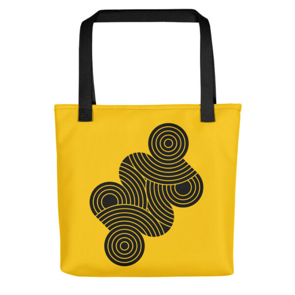 yellow tote bag with black handles and an abstract design of black circles