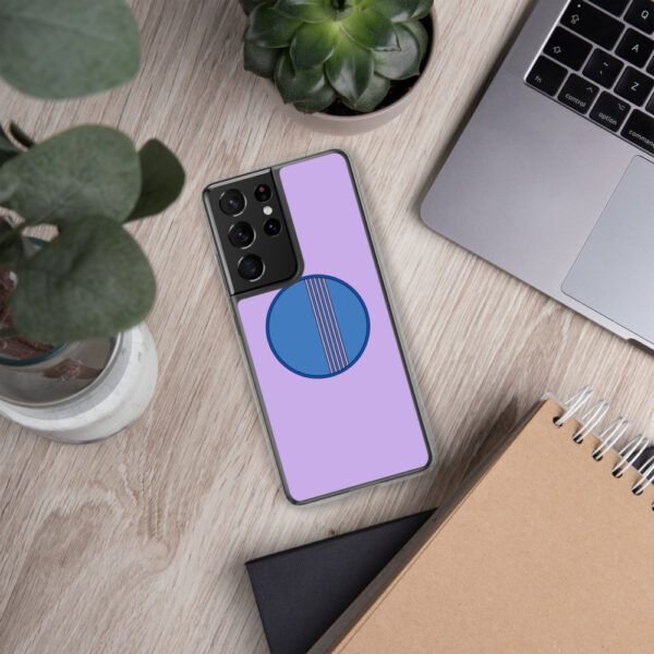 samsung phone case with a minimalist blue circle design on a purple background sitting next to a laptop