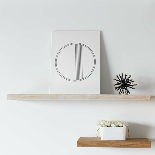 vertical stretched canvas art print with a black circle design on a white background sitting on a shelf