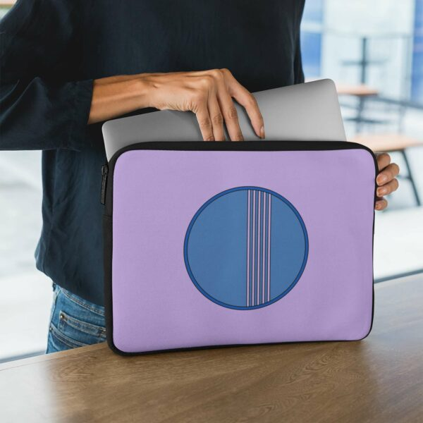 person holding a laptop sleeve with a minimalist blue circle design on a purple background