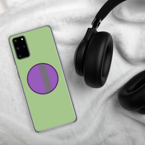 samsung phone case with a minimalist purple circle design on a green background sitting next to headphones