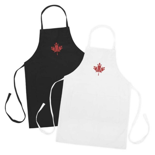 two aprons, one black, one white, both with an embroidered red maple leaf design in the center