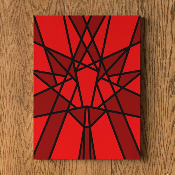 vertical stretched canvas art print with a red geometric maple leaf design hanging on a wall