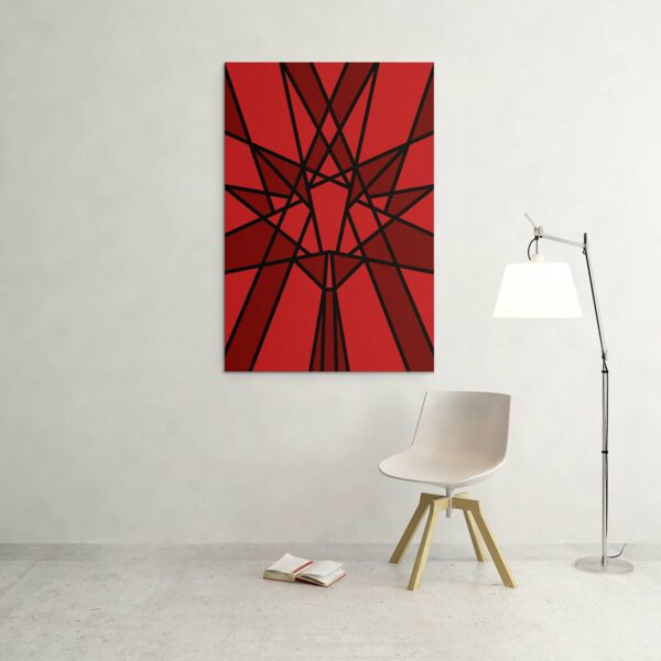 large vertical stretched canvas art print with a red geometric maple leaf design hanging on a wall