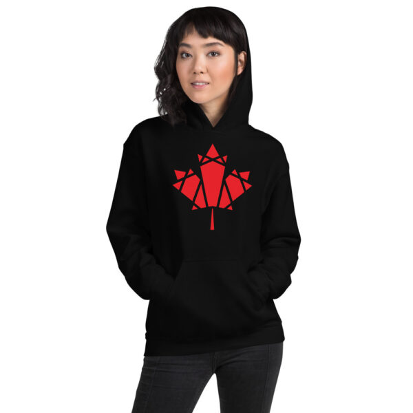 woman wearing a black hooded sweatshirt with a geometric red maple leaf design on the chest