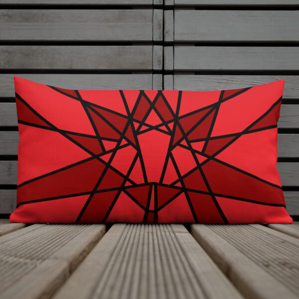 rectangle pillow with a geometric red maple leaf design sitting on a deck