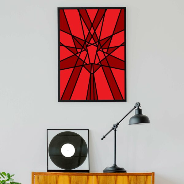 vertical fine art print with a geometric red maple leaf design in a black frame hanging on a wall