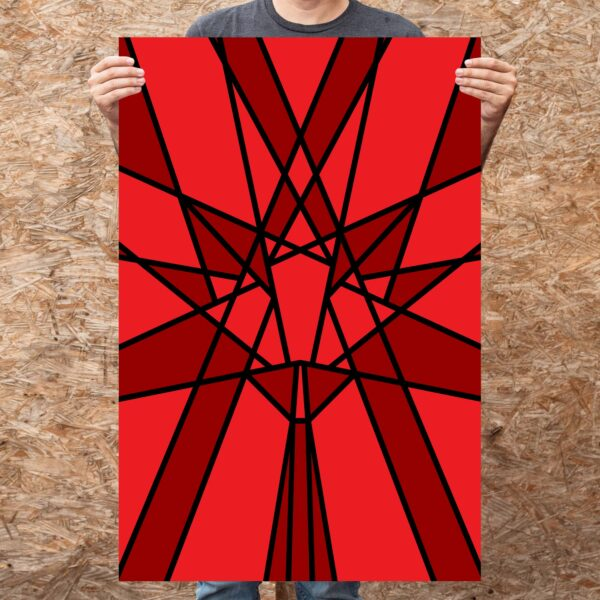 person holding a large vertical fine art print with a geometric red maple leaf design