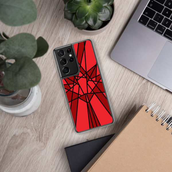 samsung phone case with a geometric red maple leaf design sitting next to a laptop
