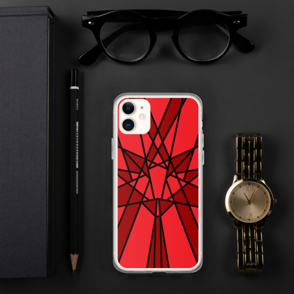 iphone case with a geometric red maple leaf design sitting next to a watch