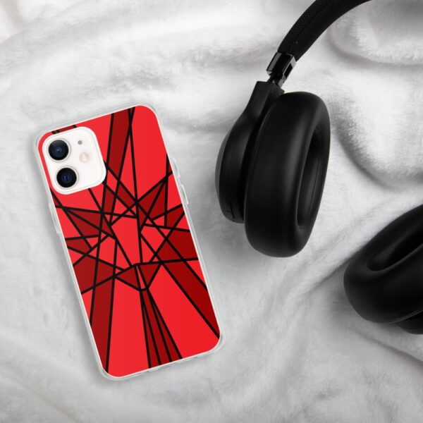 iphone case with a geometric red maple leaf design sitting next to headphones